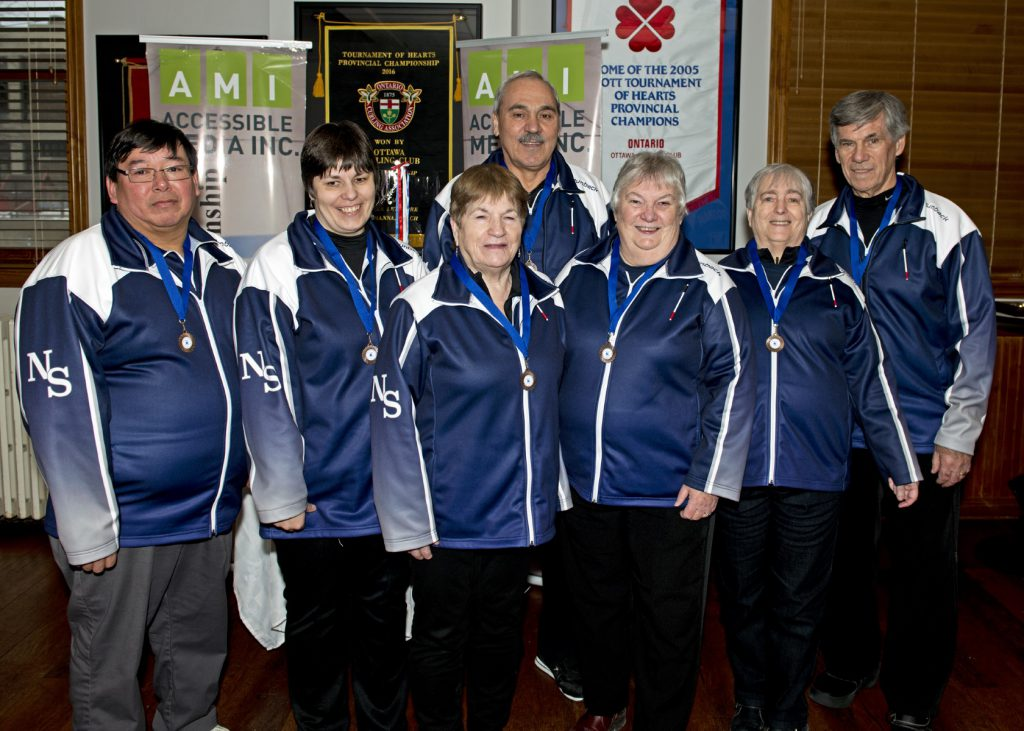 ​Bronze Winners ​Team Nova Scotia Left to Right: Sydney Francis (Guide/Coach), Terry Lynn MacDonald (Second/Sweeper), Chris Lewis (Third), John Marusiak (Coach/Guide), Louise Gillis (Skip), Joyce Wells (Lead), Mike Vrooman (Second/Sweeper)