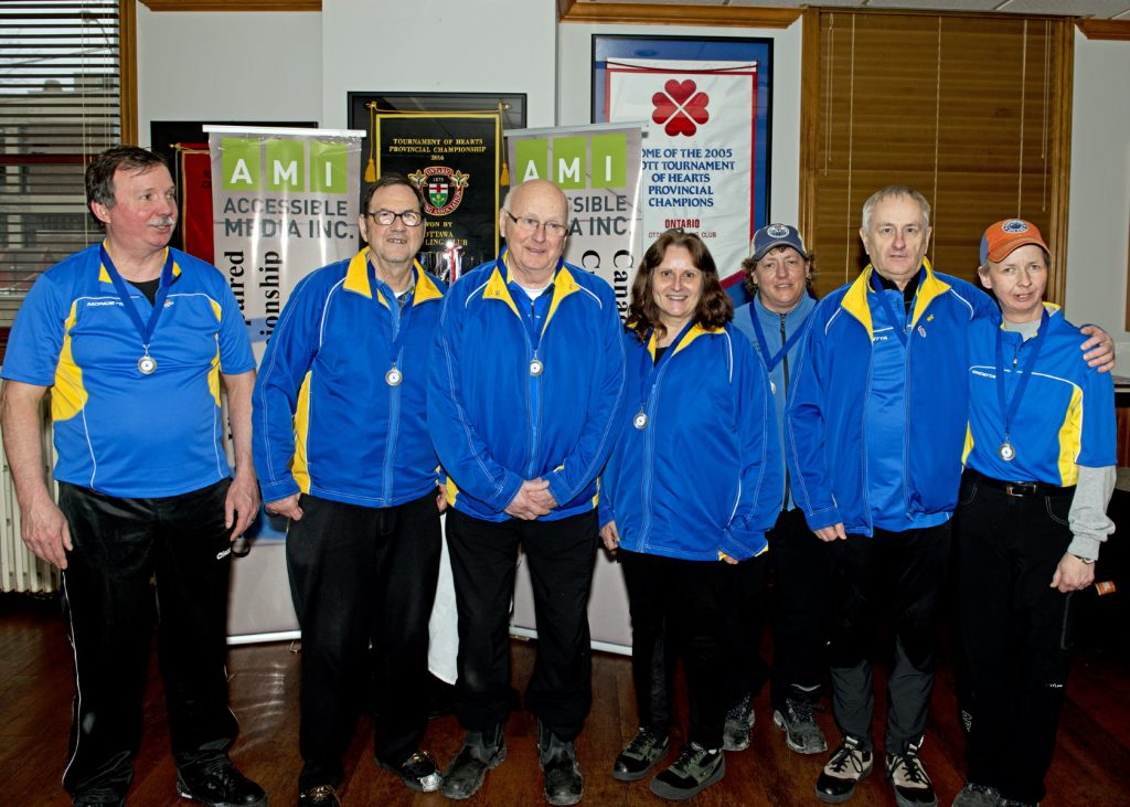 Silver Winners Team Alberta Left to Right: David Erno (Second), Jim Haydon (Sweeper), Roger Morin (Third), Leora Jevne (Coach), Mandy Collins (Guide), Gerry Chevalier (Lead), Natalie Morin (Skip)​