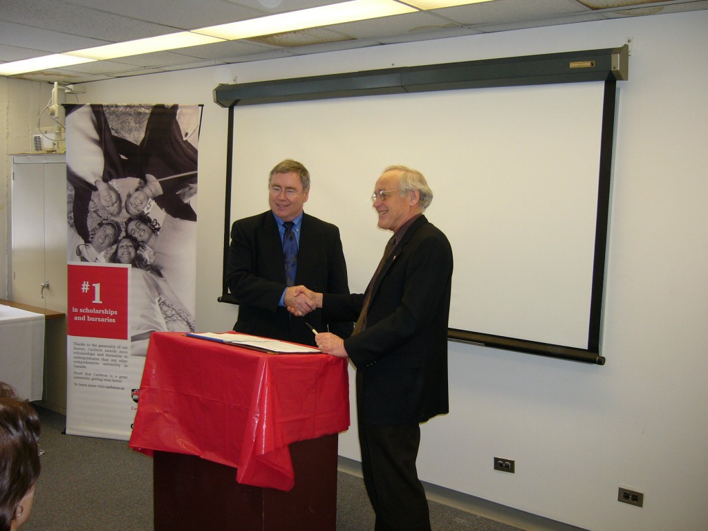 President Richard Van Loon of Carleton University and Jim Prowse, Executive Director of CCB sign $ 1 million Bursary Program