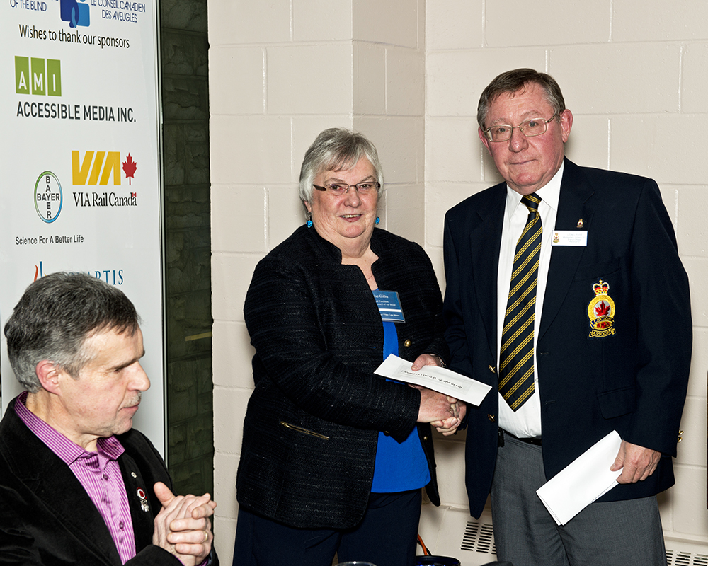 Lionel Rowe Montgomery Legion Presents Cheque to CCB