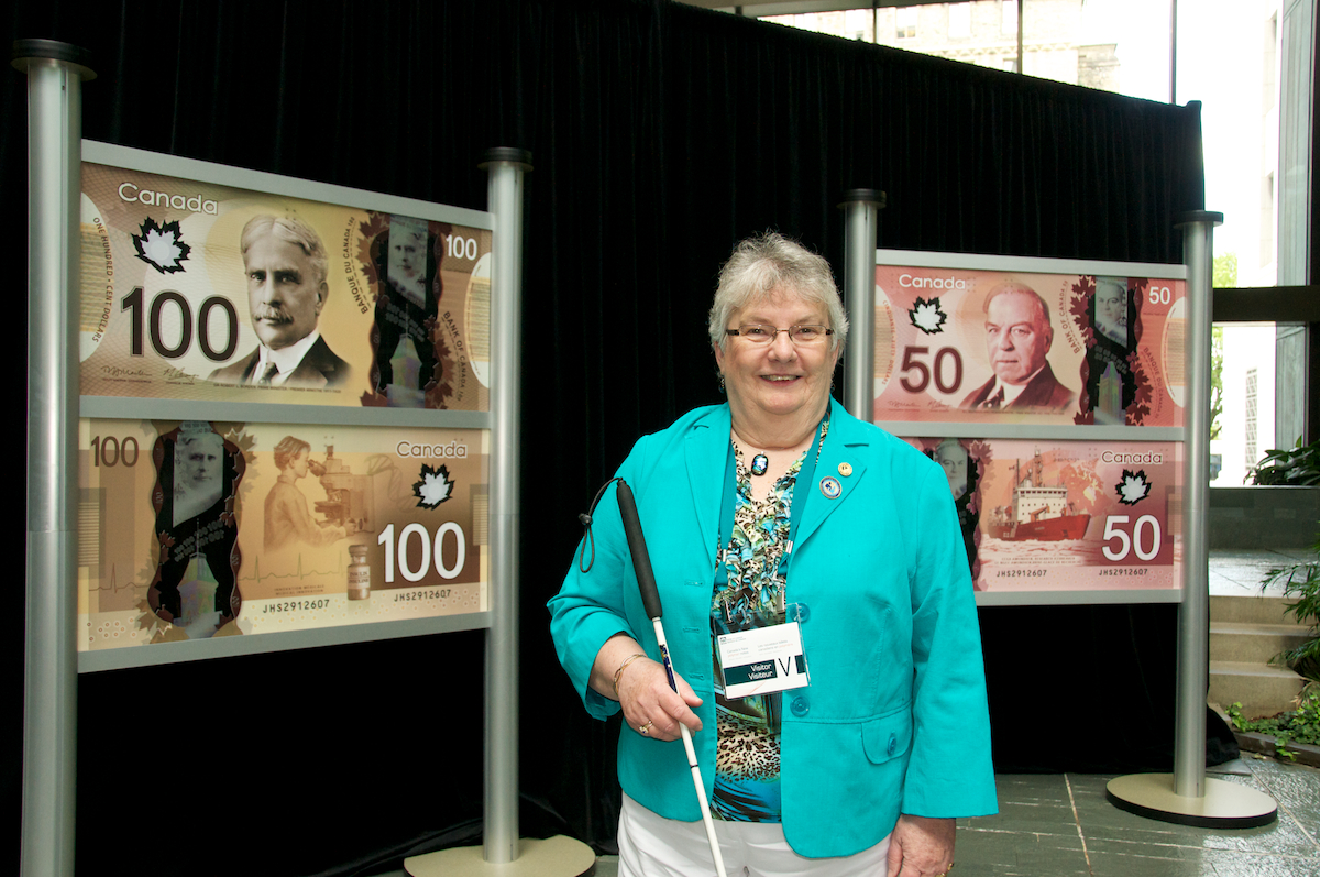 CCB President, Louise Gillis, was a guest at the unveiling of the new accessible $50.00 and $100.00 banknotes at the Bank of Canada in June 2011.