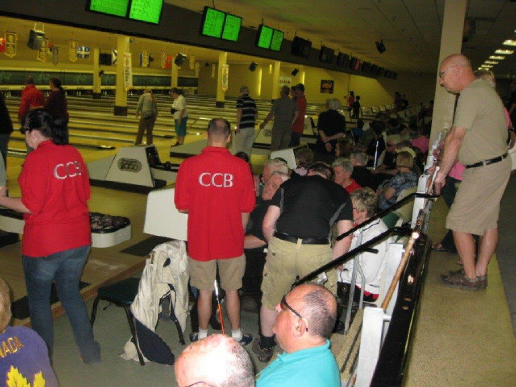 Bowlers confer about strategy as they participate in the bowling competition of the 2012 Atlantic Sports & Rec Weekend.