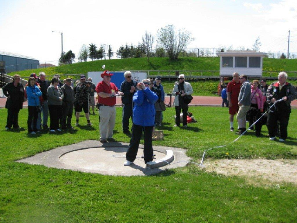 Joyce Wells (Sydney, NS Chapter) lining up her shotput throw.