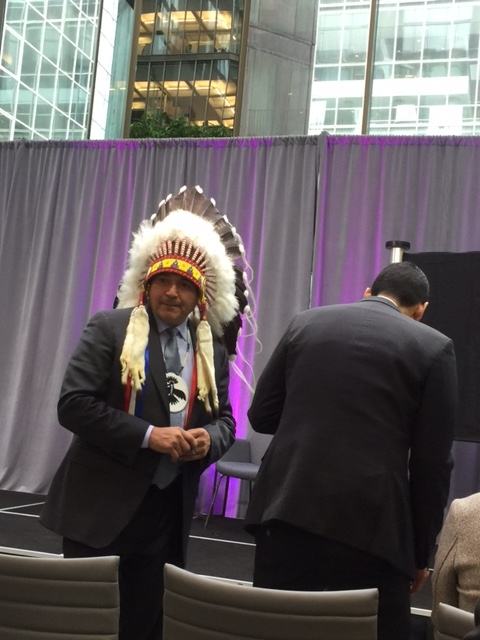 Chief Perry Bellegarde rises from his seat.
