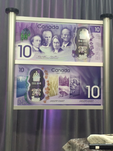 a large copy of both sides of the new $10 note