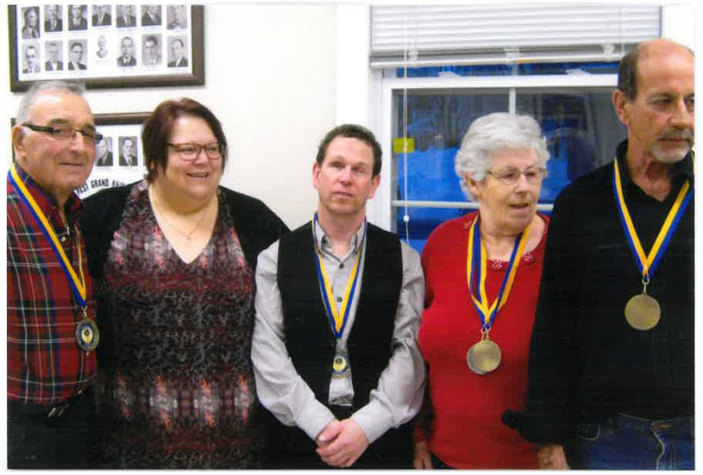 Thomas Boucher, Nancy Roy, Denis Roy, Anita Boudreau, and François Boudreau stand for a picture wearing their medals.