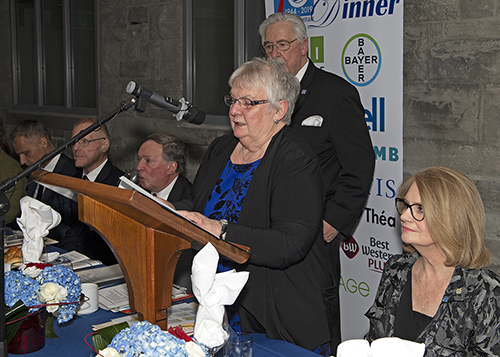 Louise Gillis speaking at a podium during the White Cane Dinner