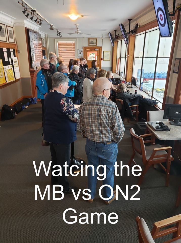 A crowd of people watching the Manitoba vs Ontario 2 game.