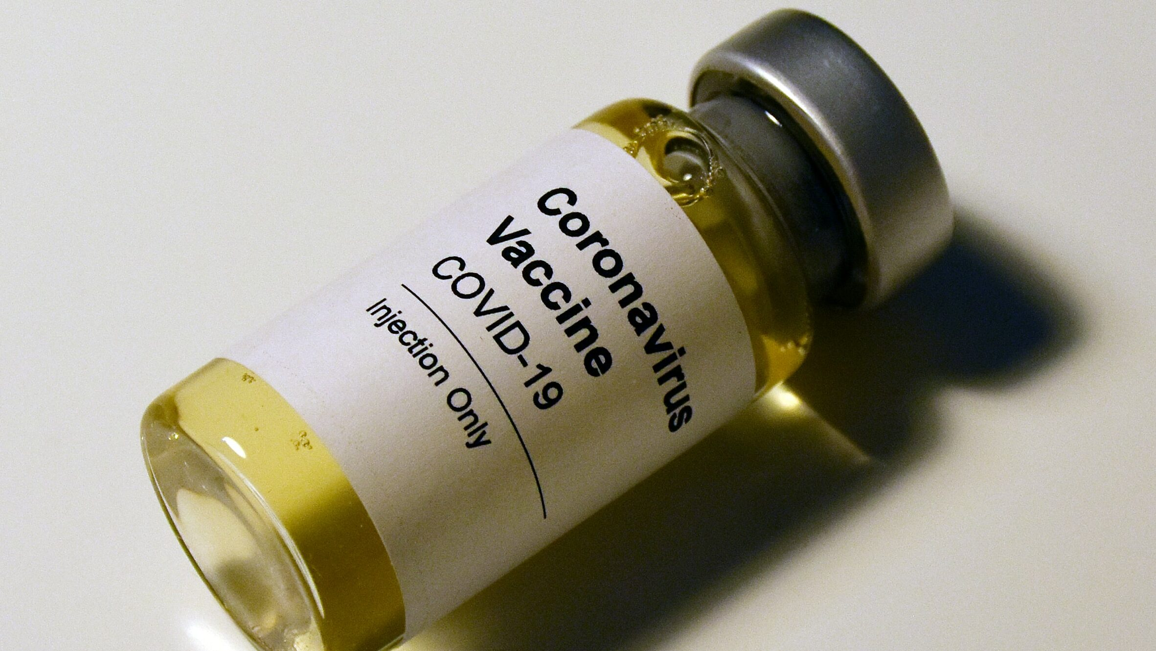 A vial reading Coronavirus Vaccine COVID-19 Injection Only.
